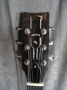 Headstock with wine bottle inlay
